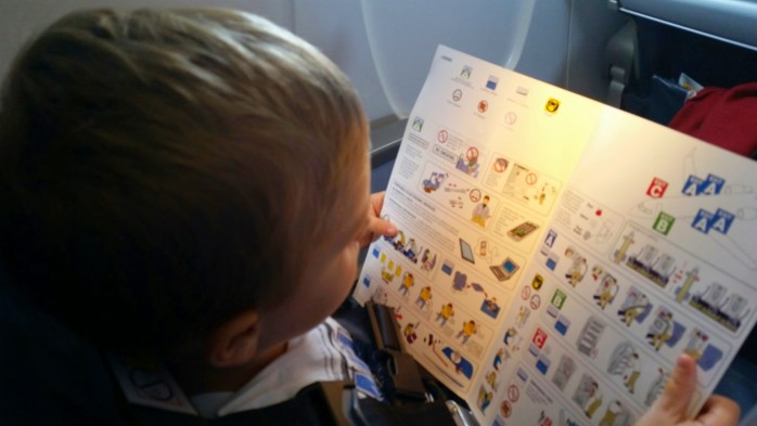 Son Reads Safety Card Mesa CRJ-900